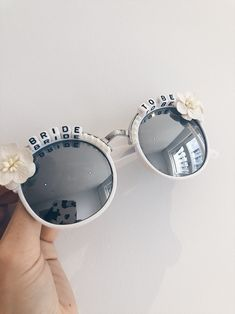 bride accessories Hello coolest bride sunglasses ever! These bride to be sunnies make a great gift for a bride for her hen party or wedding. Hen Party Bags, Hen Party Gifts, Hen Party Accessories, Bride Accessories, Hen Night Ideas, Stocking Stuffers For Women, Round Frame Sunglasses, Team Bride, Sunglass Frames