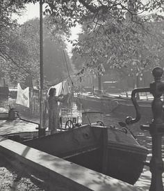 1950-1955. Woman doing the laundry on a freight vessel docked in a canal in Amsterdam. Photo Kees Scherer. #amsterdam #1950 #Canals