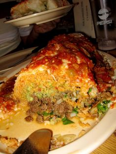 let's go there...saw this place on Man vs. Food today...Manuel's special burrito- El Tepeyac, East L.A