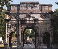 Arch of Tiberius, Orange, France, c. 25 AD. 2 attics, top have Romans and Gauls fighting, then ship rostra captured showing victory, then captured Gallic arms and finally captured Gauls with sea monsters on short sides. Mostly richly decorated Gallic arch preserved, universality of Roman power on both land and sea.