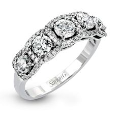 This eye-catching white gold modern band features multiple exquisite halos set with 1.33 ctw glistening round cut white diamond accents.