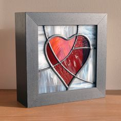 Framed mosaic glass heart from Radiance Stained Glass. The frame here is very deep so the heart can safely stand on window ledges, shelves or side tables.