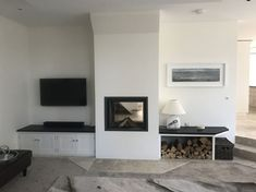 Double sided Stuv wood burner installed by Kernow Fires in Cornwall. This Side was finished in plaster and painted white. #double #sided #stuv #fire #fireplace #log #store #bespoke #inset #living #room #lounge #design #interior #kernowfires #wadebridge #redruth #cornwall