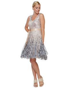 This gorgeous dress features ribbon and mesh detailing on a floral base. It has a V-neck. Flowy Skirt, Skirt Pants, Mid Length, Style Icons, Gorgeous Dress, Ribbon, Detail, Icon Fashion, Formal Dresses