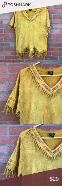 """Vintage 90's mustard tie dye fringe t-shirt L, 327 This amazing mustard tie dye fringe boho tee is perfect for a festival or boho look. It is 100% made in the US cotton, and is a size Large.  It measures 23"""" flat unstretched across the bust and is 29"""" long.  It has amazing fringe along the neckline, sleeves and bottom hem (which is in a zigzag pattern! Such a cool piece! It's in excellent preowned condition with no known flaws. Vintage Tops Tees - Short Sleeve"""
