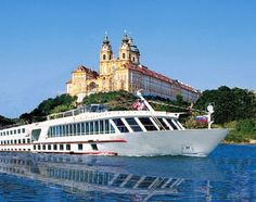 A Viking river cruise ship sails down the Danube past Melk Abbey in Austria.