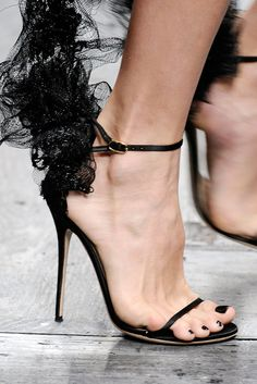 valentino spring 2010 / lace wings arching upwards from the heels