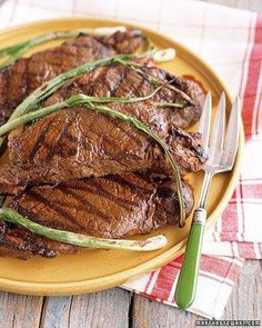 Grilled Marinated Strip Steak with Scallions: a marinade of Worcestershire, mustard, cumin, and lemon zest lends lively flavor to juicy strip steaks. Grilled Steak Recipes, Grilling Recipes, Beef Recipes, Cooking Recipes, Marinated Steak, Szechuan Recipes, Yummy Recipes, Surimi Recipes, Endive Recipes