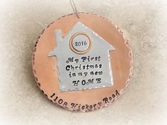 """First Christmas in our or my new home house ornament personalized with address and year. Copper and silver with hammered edges. Bought a home this year? Awesome! It's time to celebrate! This adorable copper and silver ornament is stamped with either """"Our first Christmas in our new home"""" or My first Christmas in my new home"""" or we can even say """"First Christmas in the new home"""". We stamp an address along the bottom and a year on the little disc on the roof. This copper and aluminum ornament..."""