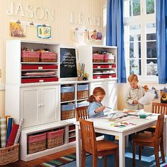 Another kids playroom idea-Love the storage for art supplies and love the idea of putting the boys names on the wall