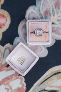 Pink stone engagement ring in a velvet box | Photo by Unfading Beauty Photography
