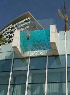 Clear bottom hanging off a balcony swimming pool