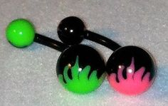 Flaming belly ring- Fire design on bottom and top of naval piercing.  Flexible plastic with acrylic ends.Available in pink/black or green/black. $2.50 each