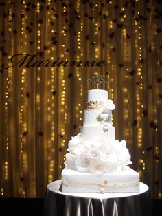 Grand tiered white and gold wedding cake with sugar flowers // Top 10 Wedding Cake Creators in Malaysia - Part 1