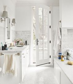 penny tile floor. marble tile walls. lovely white bathroom.