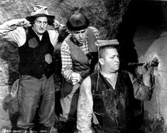 CASH AND CARRY (Episode 25-1937) The Stooges come home after several months of unsuccessful prospecting only to find that a young, crippled boy and his older sister have moved into their City Dump shack. The Stooges attempt to invest the boy's operation money by buying a house that they're conned into believing contains the treasure of Captain Kidd's kid.