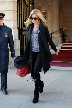 Out in Paris in a printed blouse and black leggings.