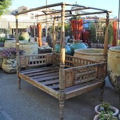 Vintage Balinese teak carved canopy daybed.  Custom outdoor / indoor upholstery cushions available.