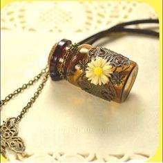 NWT Bohemian Mosaic Essential Oil Cord Necklace This is the coolest necklace ever! Have your oils close by when you need it! I use mine a lot in the summer for concerts and festivals! I get asked where I got it all the time! Hot item! Get it while you can! Boutique Jewelry Necklaces