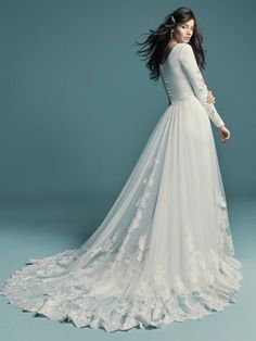 Maggie Sottero - OLYSSIA, This elegant sleeved wedding dress is comprised of Talin Stretch Crepe. Featuring a bateau neckline, scoop back, and lace illusion along the long sleeves. Making A Wedding Dress, Weeding Dress, Wedding Dress Train, Gorgeous Wedding Dress, Western Wedding Dresses, Wedding Dresses For Girls, Designer Wedding Dresses, Bridal Dresses, Prom Dresses