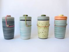 More large BEN FIESS porcelain jars now available. Just as lovely as the first batch. Porcelain bodies, glazed interiors (can hold solids and liquids) and colorful outsides with rubber band closure...