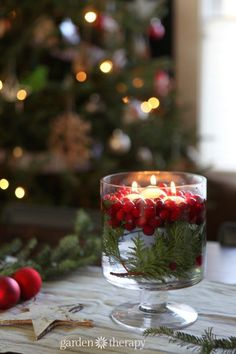 Gorgeous Cranberry Candle Table Decoration plus more Super Simple Holiday Decorating Ideas