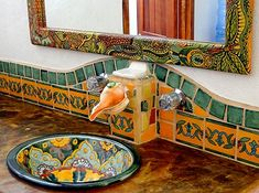 Unique touches of Mexico set the rooms apart, such as a hand-painted Framed Mirror, talavera tile, Whelk shell faucet, talavera hand-painted sink, mosaic floors and Hand Crafted light fixtures.