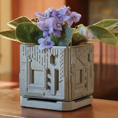 """Freeman Planter - This planter is adapted from Frank Lloyd Wright's concrete block system for the Freeman House known as """"Textile Blocks"""" (Los Angeles, California, 1923). Made of cast concrete, it is suitable for indoor or outdoor use. 4-1/2""""w x 4-1/2""""d x 5""""h."""