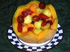 Fruit Salad in a Cantaloupe Basket-include watermelon, pineapple, and a little peach pie filling as glaze.  Use the watermelon as the basket