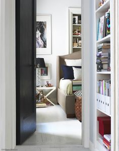 LOVE the bookcase behind the bed!