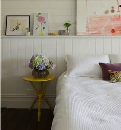 White bedroom, panelling acts as headboard and display