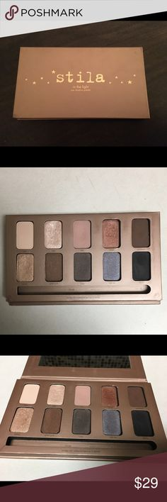 Stila In The Light Eye Shadow Palette Gently used Limited Edition Stila In The Light eyeshadow palette (no longer available). Includes the iconic shade 'kitten'. This palette does come with a mirror. Authentic.                                        No trades. I do not negotiate prices in the comments Makeup Eyeshadow
