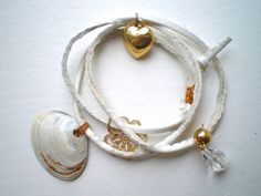 White Leather Wrap Bracelet With Seashell and Gold Charms. €14,00, via Etsy.