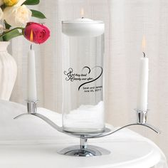 Unity set includes clear glass cylinder vase and candle printed with choice of design and 2 lines of text, 2 white taper candles and silver candle stand.