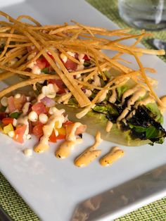 Sit outside at Glenmorgan and start dinner off with the Chef's Special Charred Romaine Heart #Salad with white corn-tomato salsa, chipotle ranch dressing, and crispy tortilla strips.