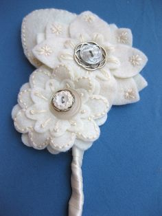 Beautiful felt and button corsage/boutonniere.