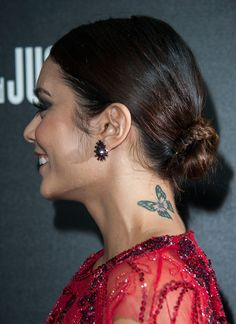 Pin for Later: Jaime King Got an Elegant Rose Tattoo, Plus More Celebrity Ink Vanessa Hudgens Vanessa flashed her colorful butterfly tattoo with this chignon hairstyle.