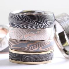 Choose from our Mokume Gane, Damascus steel or meteorite rings. From the top -> down  Damascus steel starlight pattern, Mokume of gold and .925, meteorite layered with gold, vintage Damascus gun barrel.#chrisploofdesigns