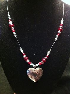 This beautiful Heart Locket necklace with accents in clear and red Swarovski crystals is the perfect style choice for a Valentine's Day celebration. Try for a chance to WIN this necklace!   To enter your name into the drawing please share this contest with friends and family by pinning on Pinterest and posting on FaceBook from the original.  All names will go into a drawing on February 8th, I will send out the necklace as soon as I get the winners address.