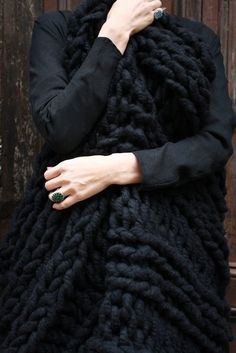 Chunky black knitted throw: source  link