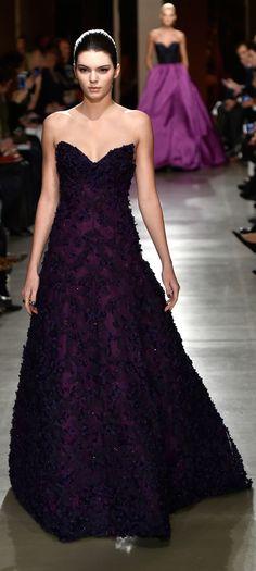 Kendall wore a gorgeous deep plum gown with floral appliqués at Oscar de la Renta.