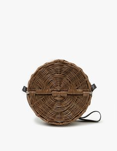 Crossbody bag from Rachel Comey in Clove. Black adjustable leather strap. Front opening with magnetic fastening. Suede lined. Polished silver hardware.    •Wicker  •Leather lining  •Made in the Philippines