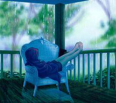 Фото Девушка сидит на веранде и смотрит на дождь