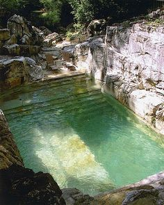 backyard pool built into an existing limestone quarry
