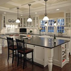 Windows,  LOVE the large island with lots of seating and table legs. Beadboard hood. Farm sink. Glass front white cabinets.  Ceiling. Farmhouse kitchen