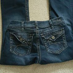 Silver Jeans. Like new Dark wash, faux tab pockets, suki surplus.  Worn a few times. 30 x 34 Silver Jeans Jeans Boot Cut