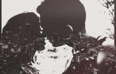 Double exposure. Couple, city, night.