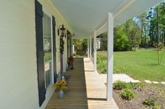 Love this porch. Perfect for sitting and watching the kids play.  10625 Simms Rd