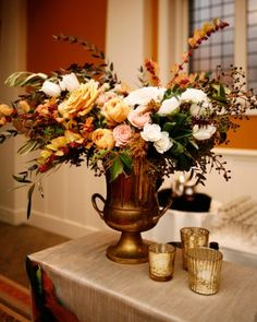 I like to see candle holder with lighted candles at bar, desert, food  tables, wishing tree table... flower colors for a fall wedding