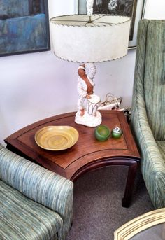 A 1955 Universal Statuary Corporation of Chicago chalkware table lamp of a Conga Drum player with a vintage fiberglass shade with woven trim. The conga drum was popularized in the 1950's when Latin music swept the United States. Desi Arnaz played a role in the conga drum trend. Universal Statuary began production in the late 1930's in Chicago. They produced mainly traditional Italian designs out of plaster/chalkware.